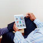 business owner reviews digital advertising analysis