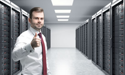 Man with Thumb Up in Server Room